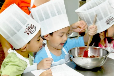 Kids join The Maya Kitchen Summer Workshops